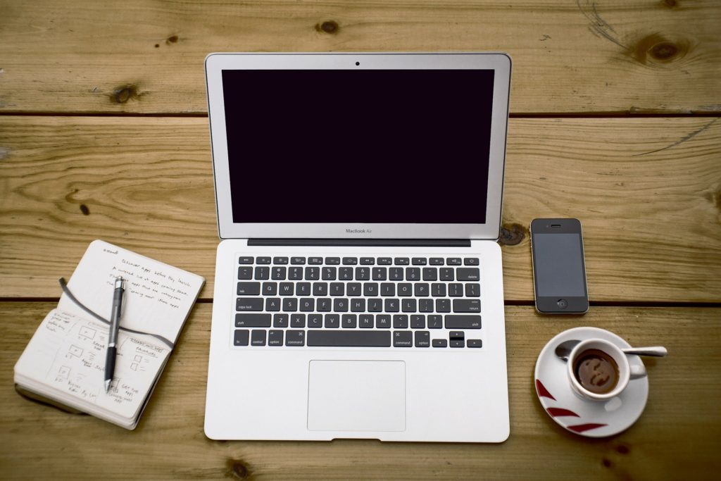 laptop with coffee and note book